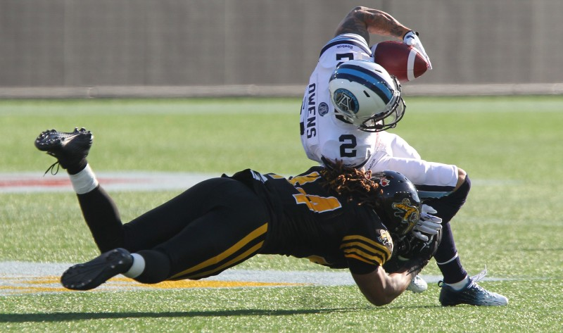 Toronto's Chad Owens is tackled by Hamilton's Taylor Reed during second quarter CFL Eastern Semi-Final action in Hamilton on Sunday, Nov.15, 2015. (CFL PHOTO - Dave Chidley )