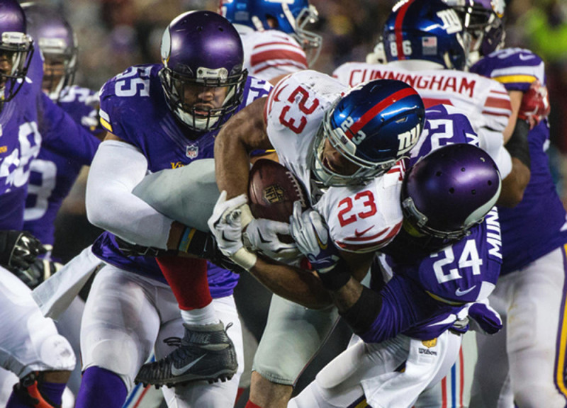 Dec 27, 2015; Minneapolis, MN, USA; New York Giants running back Rashad Jennings (23) is tackled by Minnesota Vikings cornerback Captain Munnerlyn (24) and linebacker Anthony Barr (55) during the second quarter at TCF Bank Stadium. Mandatory Credit: Brace Hemmelgarn-USA TODAY Sports