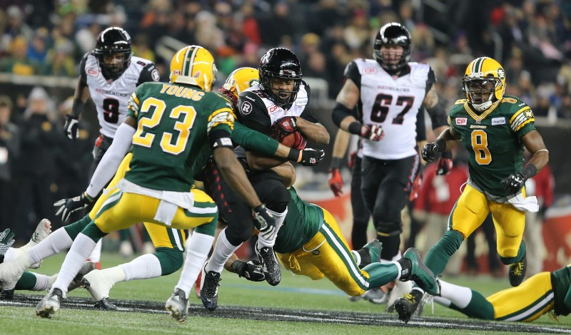 Ottawa Redblacks DB William Powell is brought down by Edmonton Eskimos defenders during third quarter CFL action during the 103rd Grey Cup game in Winnipeg on Sunday, Nov. 29, 2015. (CFL PHOTO - Jason Halstead)