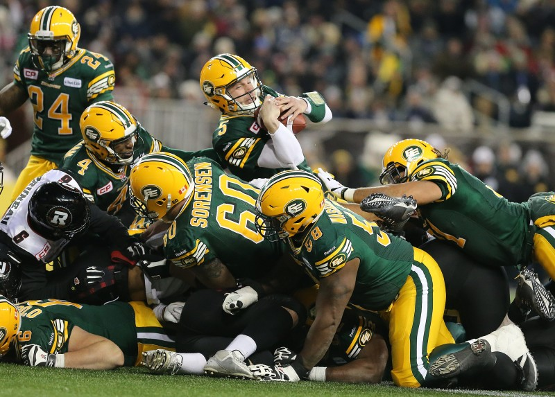 Edmonton Eskimos QB Jordan Lynch rushes in for a TD against the Ottawa Redblacks during fourth quarter CFL action during the 103rd Grey Cup game in Winnipeg on Sunday, Nov. 29, 2015. (CFL PHOTO - Jason Halstead)