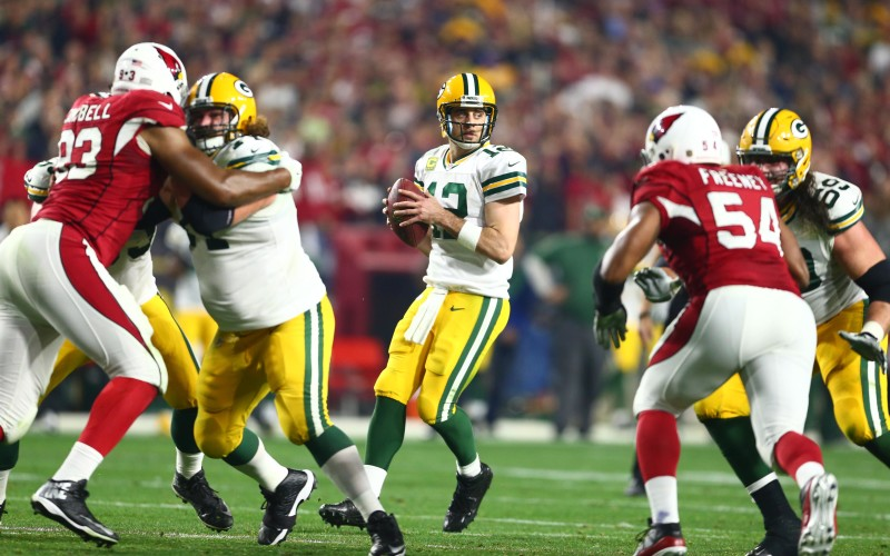 Jan 16, 2016; Glendale, AZ, USA; Green Bay Packers quarterback Aaron Rodgers (12) drops back to pass against the Arizona Cardinals during the second quarter in a NFC Divisional round playoff game at University of Phoenix Stadium. Mandatory Credit: Mark J. Rebilas-USA TODAY Sports