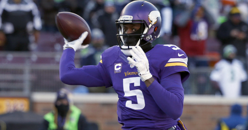 Minnesota Vikings quarterback Teddy Bridgewater (5) warms up before an NFL wild-card football game against the Seattle Seahawks, Sunday, Jan. 10, 2016, in Minneapolis. (AP Photo/Jim Mone)