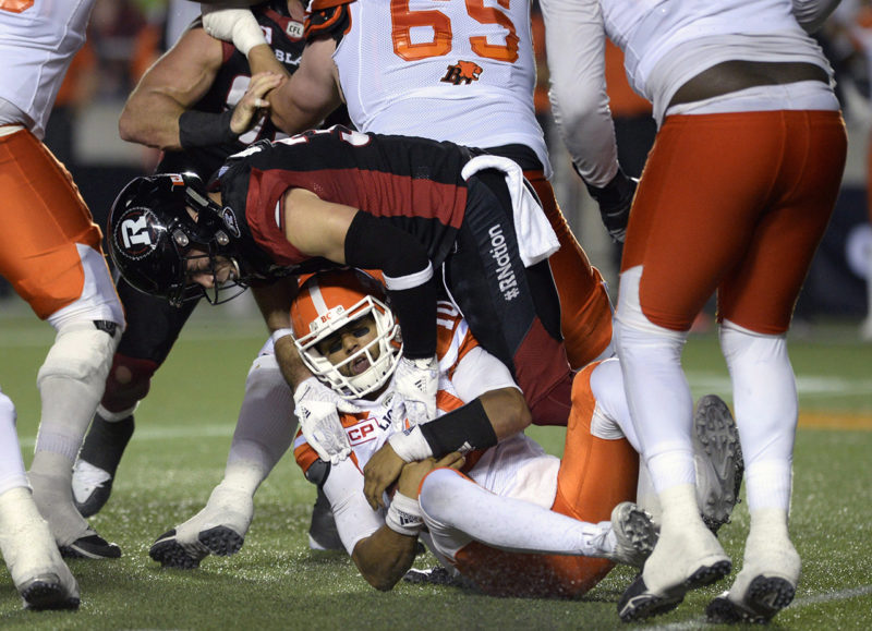 B.C. Lions quarterback Jonathon Jennings (10) gets sacked by Ottawa Redblacks' John Boyett (31) during first half CFL action on Thursday, Aug. 25, 2016 in Ottawa. THE CANADIAN PRESS/Justin Tang