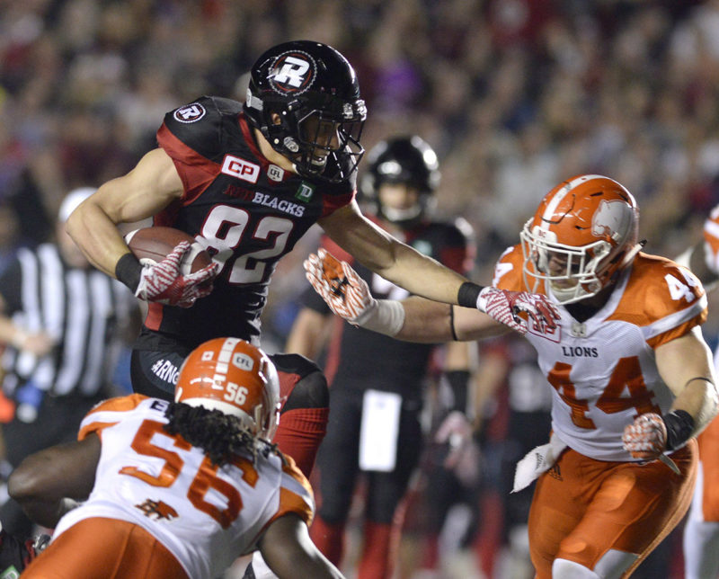 Ottawa Redblacks' Patrick Lavoie (82) jumps to keep B.C. Lions' Adam Bighill (44) and Solomon Elimimian (56) away from the ball during first half CFL action on Thursday, Aug. 25, 2016 in Ottawa. THE CANADIAN PRESS/Justin Tang