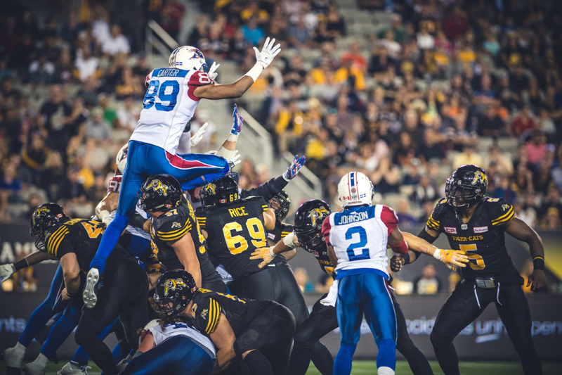 Duron Carter (89) jumps to block the field goal during the game between the Hamilton Tiger-Cats and the Montreal Alouettes at Tim Hortons Field in Hamilton, ON. Friday, September 16, 2016. (Photo: Johany Jutras)