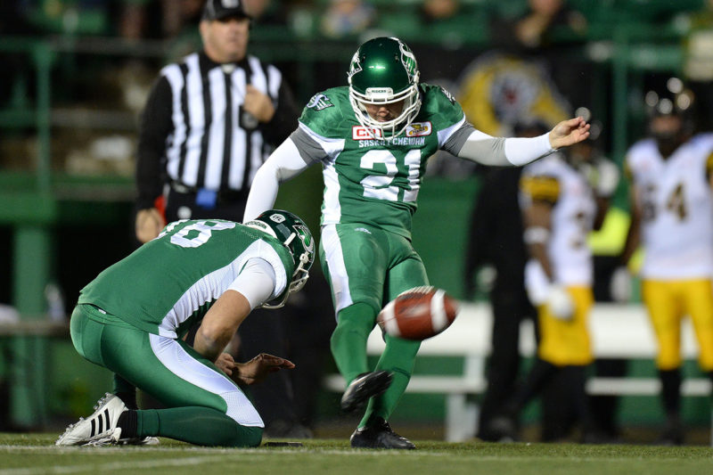 Tyler Crapigna #21 of the Saskatchewan Roughriders kicks the ball during first quarter CFL action in Regina on Saturday, Sept. 24, 2016. (CFL PHOTO - Troy Fleece)