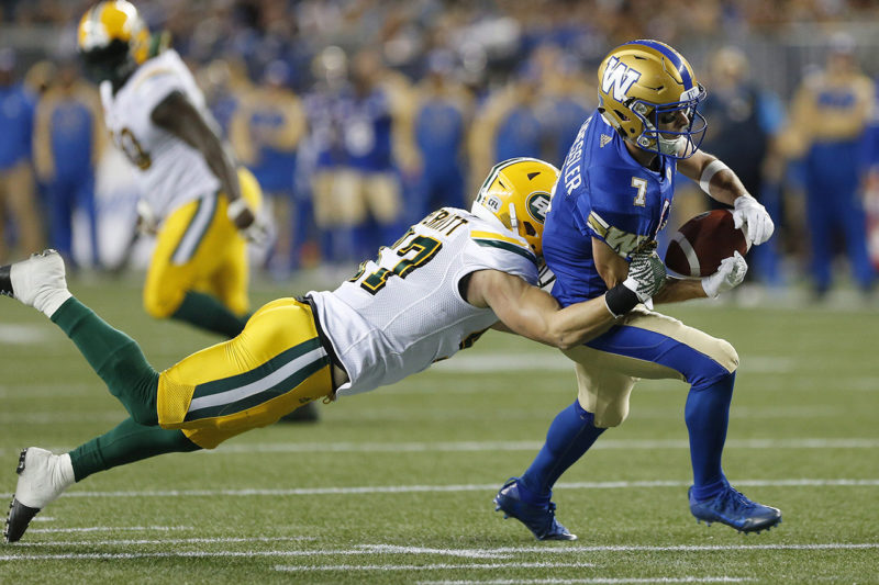 Edmonton Eskimos' JC Sherritt (47) strips the ball from the hands of Winnipeg Blue Bombers' Weston Dressler (7) during the first half of CFL action in Winnipeg Friday, September 30, 2016. THE CANADIAN PRESS/John Woods