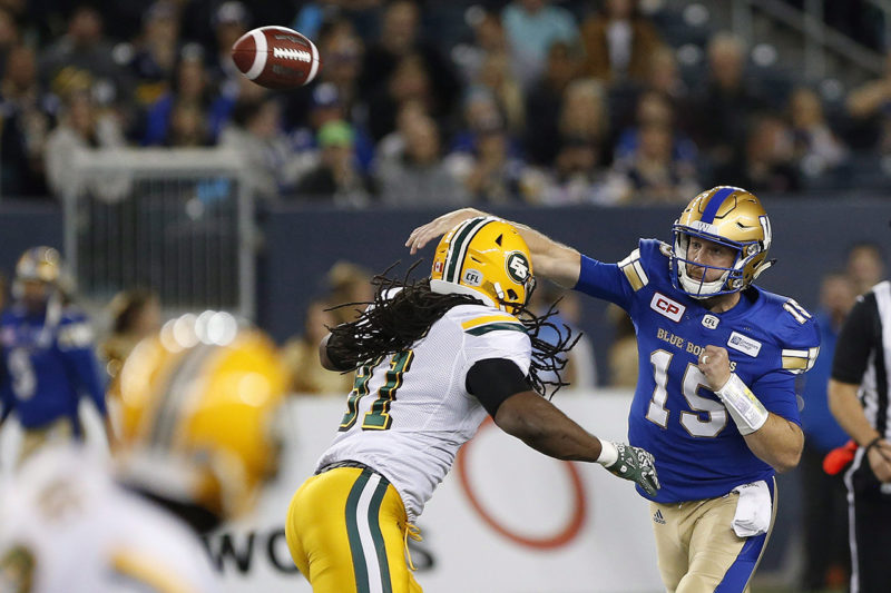 Winnipeg Blue Bombers quarterback Matt Nichols (15) throws under pressure from Edmonton Eskimos' Marcus Howard (91) during the first half of CFL action in Winnipeg Friday, September 30, 2016. THE CANADIAN PRESS/John Woods