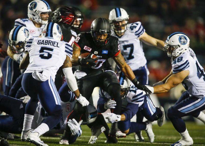 Toronto Argonauts' Jermaine Gabriel, left, tries to bring down Calgary Stampeders' Jamal Nixon with his teammates during first half CFL football action in Calgary, Friday, Oct. 21, 2016.THE CANADIAN PRESS/Jeff McIntosh