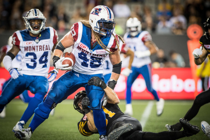 Bear Woods (48) and Matt Coates (81) during the game between the Hamilton Tiger-Cats and the Montreal Alouettes at Tim Hortons Field in Hamilton, ON. Friday, September 16, 2016. (Photo: Johany Jutras)