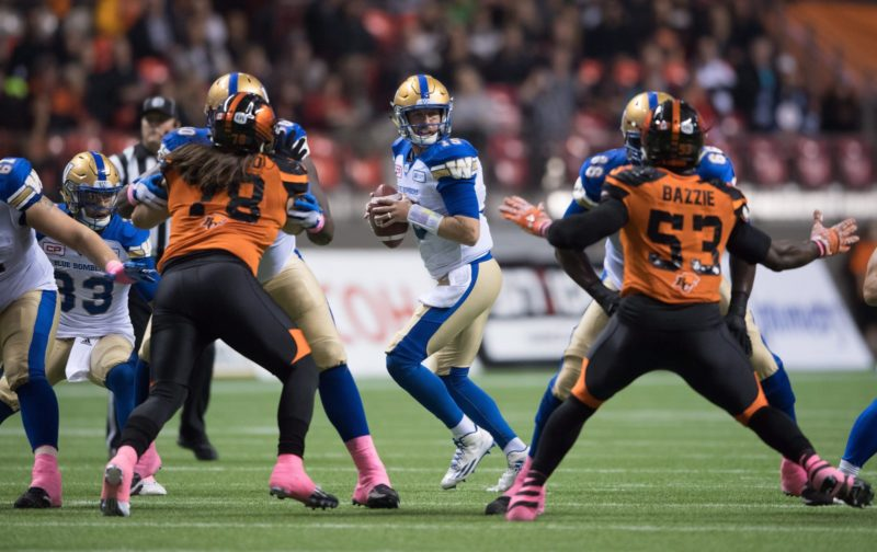 Winnipeg Blue Bombers quarterback Matt Nichols, centre, looks for an open receiver during the first half of a CFL football game against the B.C. Lions in Vancouver, B.C., on Friday October 14, 2016. THE CANADIAN PRESS/Darryl Dyck