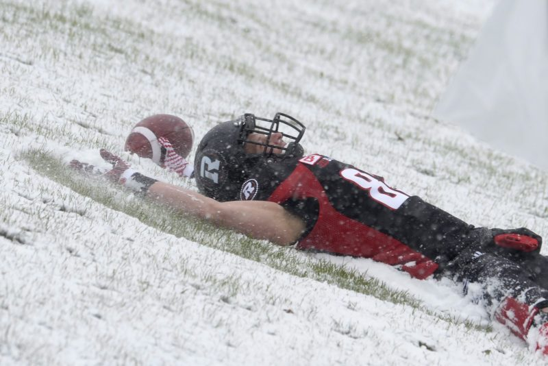 Ottawa RedBlacks' Greg Ellingson (82) makes a snow angel near the Edmonton Eskimos' end zone after scoring a touchdown during first half CFL eastern final action, in Ottawa on Sunday, November 20, 2016. THE CANADIAN PRESS/Adrian Wyld